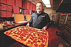 After 20 years of running Just Pizza, owner Rudy Alloy Jr. still spends 12 hours a day manning the ovens and taking orders. The main Elmwood Avenue location churns out more than 2,000 pizzas a week.
