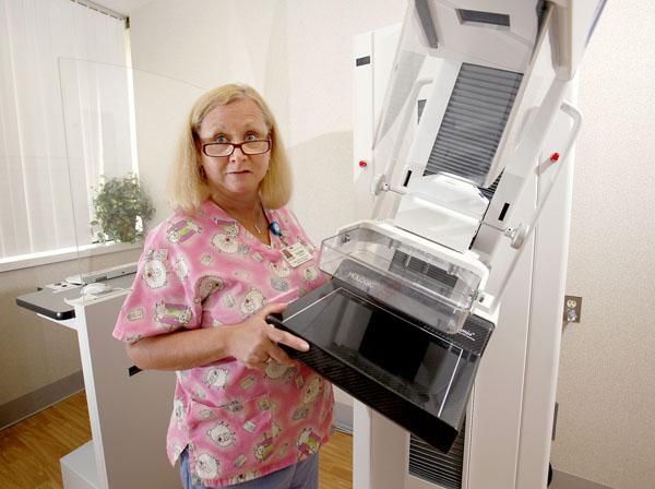Radiologic technologist Gloria Gwozdek sets up for a mammogram at Niagara Falls Memorial Medical Center's women's health center at the Summit Healthplex. The facility has emerged as the heart of a growing medical corridor in the Williams Road area of Wheatfield, a mile from Niagara Falls International Airport.