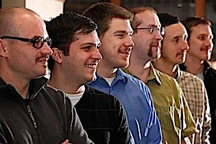 Synacor Inc. employees participate in the national mustache-growing contest, Movember. At top, from left, are Eric Musso, lead engineer, Kevin Sivic, engineering manager, Patrick Salydyga, project coordinator TV Everywhere, Darin Chambers, systems architect, Joe Pitzonka, manager, project coordination, and Adam Culver, project coordinator.