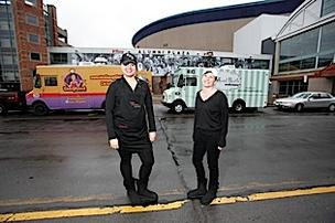 Food truck operators Kelly Brewer, left, and Alexis Andrzejak hope to attract a larger share of the lunch crowd by adding unique items to the menu.