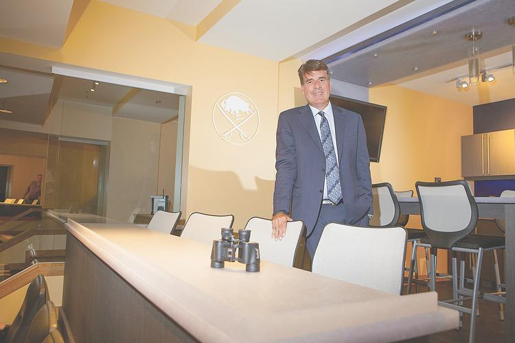 John Livsey, Buffalo Sabres vice president, shows off a suite in First Niagara Center that was remodeled as part of a three-year renovation to all 80 suites. They will feature new dining and meeting islands, below, and upgraded furnishings.