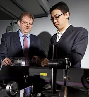 Alexander Cartwright, left, and Qiaoqiang Gan have developed an experimental polymerized light filtering system that could have applications in the biomedical field, military and even agricultural.