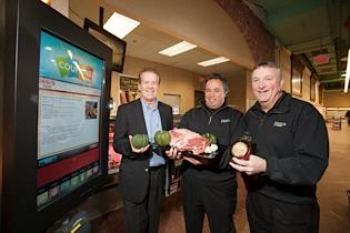 Jim Mack, left, of ShoptoCook, Joe Dash and Mark Mahoney of Dash's gathered ingredients for a maple-glazed rib roast recipe printed from an interactive touch screen in the store.