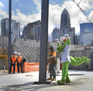 Homer the Dragon, the Charlotte Knights' mascot, was on hand Tuesday as construction crews erected the first steel beams at BB&T Ballpark.