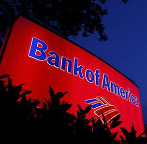 Fourth-quarter profit fell 63 percent for Bank of America.