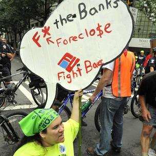 Mortgage problems continue to dog Bank of America. Hundreds of angry people protested the bank's mortgage policies among other issues at its annual meeting in Charlotte this May.
