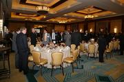 Following the networking hour, attendees at the CFO of the Year awards event file in for lunch and the program.