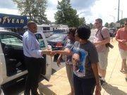 Charlotte Mayor Anthony Foxx greets Obama supporters at CarolinaFest on Monday.