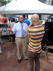 Dan Murrey, top executive at local host Committee for Charlotte in 2012 Host Committee, is interviewed by a reporter.