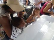 Children drink from a water station uptown during Monday's CarolinaFest.