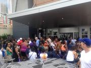 Throngs of festival-goers wait outside the Harvey B. Gantt Center for African American Arts + Culture during the CarolinaFest celebration to kick off the Democratic National Convention. The center was one of several uptown facilities to offer free or discounted admission on Monday