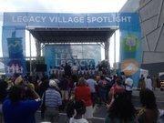 A crowd gathers in Legacy Village at CarolinaFest.