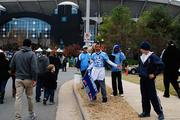 Youth sports teams raise money among tailgaters before Sunday's Carolina Panthers game.