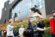 Carolina Panthers fans pour out of Bank of America Stadium after Sunday's overtime loss to the Tamp Bay Buccaneers.