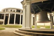 Back view of the Charlotte Museum of History, including the Freedom Bell.