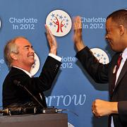 Duke Energy CEO Jim Rogers (left) and Charlotte Mayor Anthony Foxx share a high-five over the DNC's selection of Charlotte.