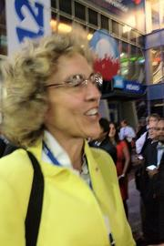 Mecklenburg County Commissioner Jennifer Roberts, briefly shut out of Time Warner Cable Arena on Wednesday evening as crowds hit capacity, sings to pass the time.