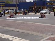 Six environmental activists were arrested Thursday afternoon after blocking the intersection next to Duke Energy Center.