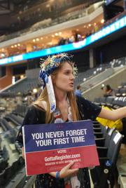 A woman works to register voters at Time Warner Cable Arena on Thursday, the final night of the Democratic National Convention.