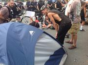 Demonstrators Tuesday placed a tent in the street, refusing to budge.Click here for more on that protest.