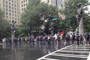 Protesters march through the square in uptown Charlotte as police hold a line to keep them to the sidewalks.Click here for more on Tuesday's protest.