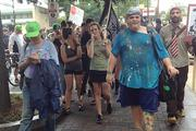 Soaked protesters march uptown after a standoff with police near the NASCAR Hall of Fame.Click here for more on that protest.
