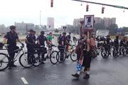 Police and protesters stand off in the rain.Click here for more on Tuesday's protest.