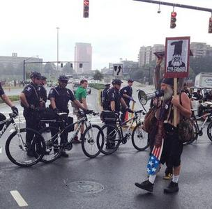 Protesters were eventually permitted to march uptown Tuesday afternoon, following a stand-off with police in the rain.