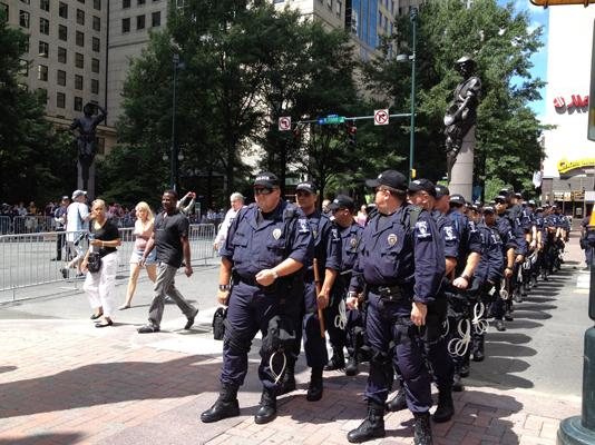"Because of the low turn-out of demonstrators at the DNC, Charlotte police had too many law enforcement officers on site, which prompts a U.S. Department of Justice report to note that future events like national conventions would benefit from ""the development of plans for de-escalating"" security."