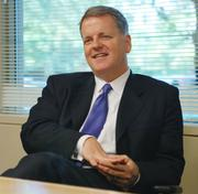 Doug Parker, now CEO of US Airways, will become the top executive at the new American Airlines.