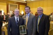 Kevin Marsh (left), chairman and chief executive of SCANA Corp., is pictured with CBJ Publisher Kevin Pitts (center) and Jeff Merrifield of The Shaw Group after receiving his Energy Leadership Award.