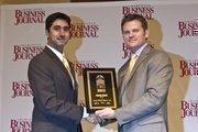 Ronak Bhatt, president of RIN Advisors, receives a CBJ Energy Leadership award.
