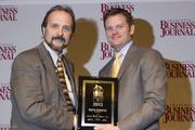 Barry Edwards, director of utilities and engineering for Catawba County, receives a CBJ Energy Leadership award.