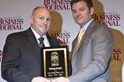 Thomas Franch, senior vice president of Areva Inc., receives a CBJ Energy Leadership award.