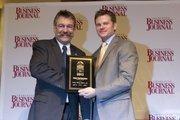 Hans Hartenstein, president of Steag Energy Services, receives a CBJ Energy Leadership award.