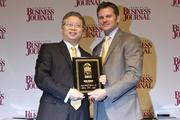 Alex Huang, director of the FREEDM Systems Center at N.C. State University, receives a CBJ Energy Leadership award.