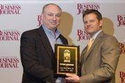 A proxy receives a CBJ Energy Leadership award on behalf of Enrique Santacana, president and chief executive of ABB North America.