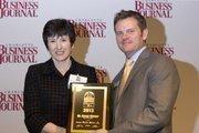 Susan Winsor, president of Aiken Technical College, receives a CBJ Energy Leadership award.