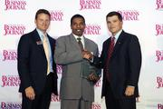 The Charlotte Business Journal's second annual Excellence in Health Care Awards program recognizes 36 honorees that are delivering the best health care in the market. Here, CBJ Publisher and President Kevin Pitts (left) and Tom Hodges (right) of event sponsor SunTrust Bank stand with Dr. Charles Bridges of Carolinas HealthCare System's Sanger Heart Institute as he accepts an award for Advancements in Health Care. Read more about the individuals and companies recognized in the Oct. 5 print edition.