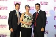 The Charlotte Business Journal's second annual Excellence in Health Care Awards program recognizes 36 honorees that are delivering the best health care in the market. Here, CBJ Publisher and President Kevin Pitts (left) and Tom Hodges (right) of event sponsor SunTrust Bank stand with Marsha Gilbert of Hospice & Palliative Care Charlotte Region as she accepts an award for Nurse of the Year.  Read more about this year's class of honorees in the Oct. 5 print edition.