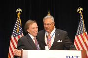 Radio personality Bob Lacey and Henry Hinton, president of eastern N.C. radio and cable TV company Inner Banks Media, announce that Pat McCrory has been declared winner in the race for the governor's office.
