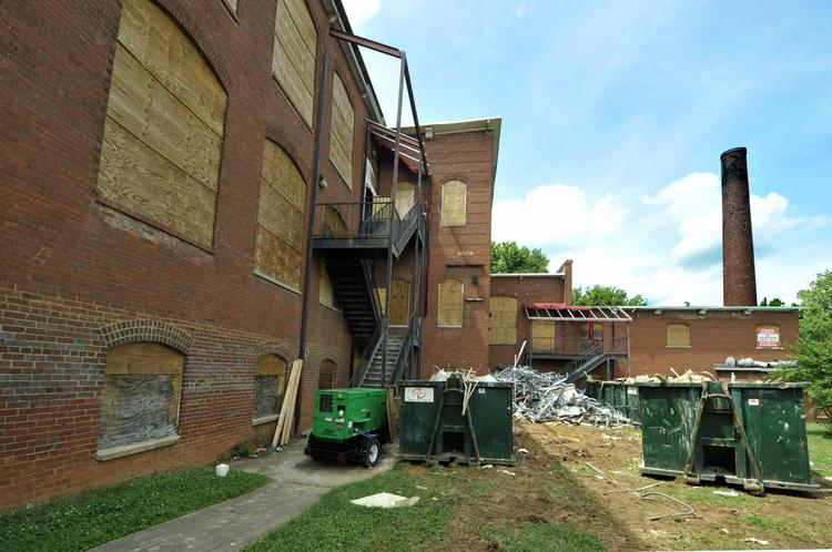 Charlotte City Council has approved a request for city money to help pay for a makeover of two historic mills in the NoDa neighborhood.