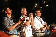 Charlotte Business Journal Editor Robert Morris (center) and writers Erik Spanberg (left) and Adam O'Daniel enjoy the entertainment provided at the Welcome Party for media covering the DNC.
