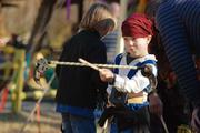 A small pirate tries his hand at juggling and balance games at one of the play tents.