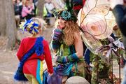 """Twig the Fairy, one of the Carolina Renaissance Festival's 500 costumed characters, delights young festival-goers with """"fairy dust"""" and """"magic"""" pebbles."""