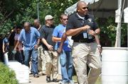 At the Charlotte Mecklenburg Police and Fire Training Academy, officers from other cities pick up bottles of water after getting off their buses.