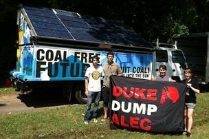 Greenpeace protesters at their portable solar unit in Frazier Park. From the left, they are Connor Gibson and Robert Gardner of the Greenpeace office in Washington, D.C.;, Kate Melges, a field organizer from Ohio; and Monica Embrey, its Charlotte organizer.