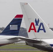 American Airlines, which is in merger talks with US Airways, reported it returned to profit in the fourth quarter.