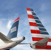The $11 billion all-stock merger of American Airlines and US Airways was the other major merger news announced in February.