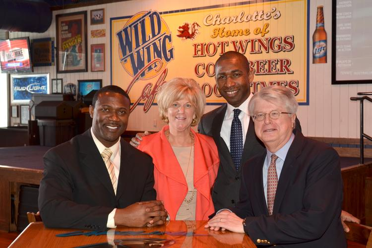 Axum Capital Partners principals meet at Wild Wing Cafe uptown. The private-equity group this week bought control of the restaurant chain. From left to right: Muhsin Muhammad, Edna Morris, Denis Ackah-Yensu and Ray Groth.